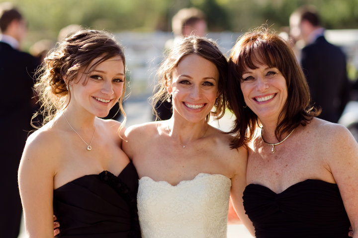 Allison, our mom, and me at the hubby's and my wedding.
